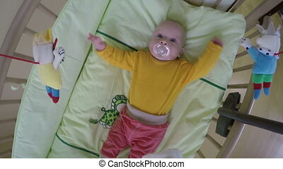 baby bed under carousel - Playful interested newborn infant...