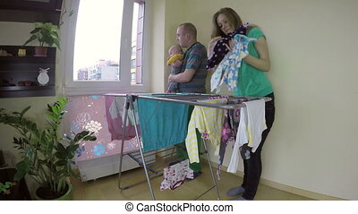 father with baby laundry - Father man hold baby on hands and...