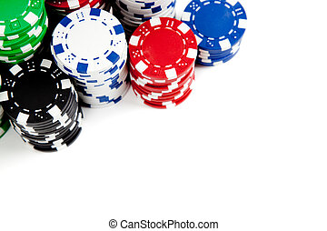 Stacks of poker chips on white with copy space