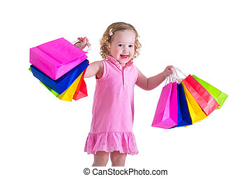 Little girl with shopping bags - Little girl in a pink dress...