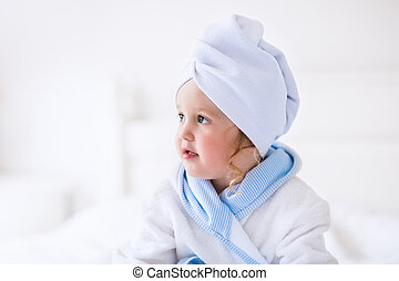 Little girl in a towel after bath