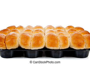 A dozen cooked rolls in a pan on white with copy space