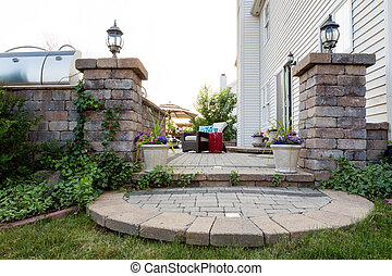 Welcoming entrance to an outdoor patio in front of a timber...