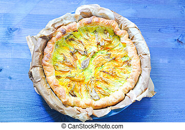 Savory pie with ricotta, parmesan and zucchini flowers
