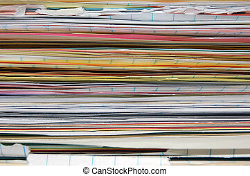 Stack of papers - A close up of various papers stacked.