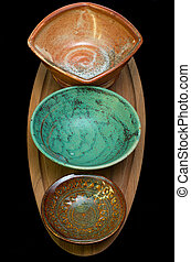 Ceramic Bowls on Serving Tray - column of ceramic bowls on...