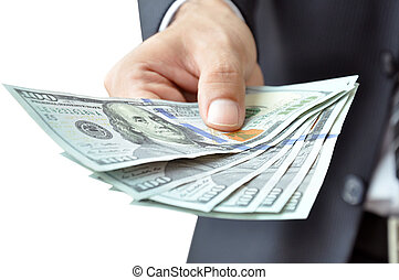 Hand giving money - United States Dollars (or USD) - on...