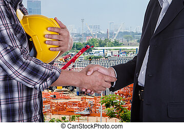 businessman shake hands with engineeringin in construction...