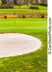 Sand trap near the hole - a sand trap bunker in a beautiful...