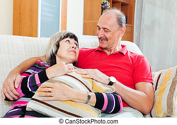 Portrait of loving  mature couple together in home