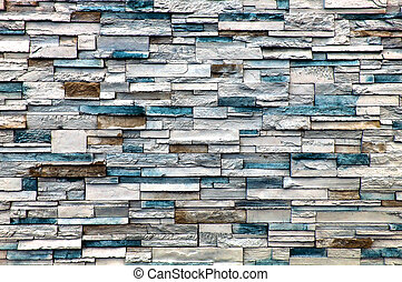 Stone Wall - A stone wall with mainly white and blue bricks,...