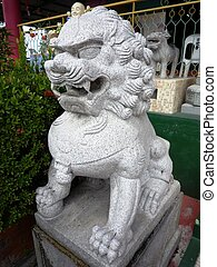 Stone lion in front of the Chinese temple