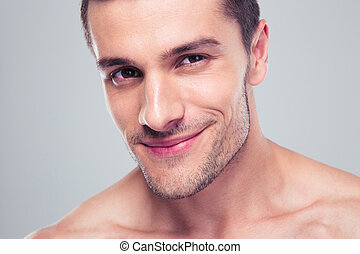 Closeup portrait of a happy man over gray background