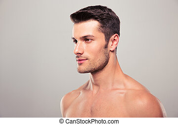 Young man with nude torso looking away
