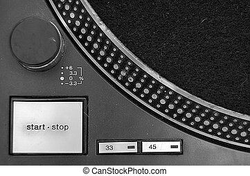 Turntable abstract - Close up of a turntable with startstop,...