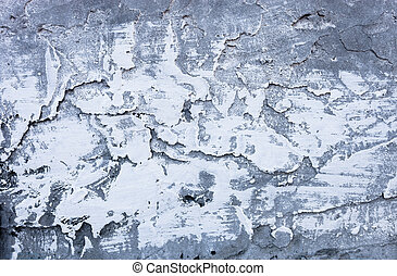 Partly whitewashed surface of the uneven hardened cement...
