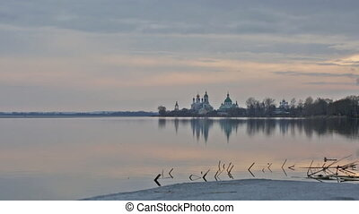 Sunset over Spaso-Yakovlevsky Monastery on Neros lake in...