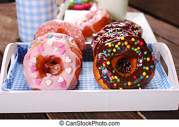 homemade donuts with chocolate and icing glaze