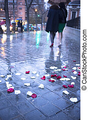 Confetti on ground after wedding marriage ceremony in rain -...