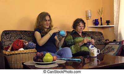 woman yarn ball needle - woman wind the yarn into ball and...