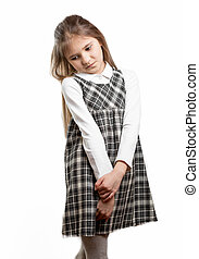 cute shy schoolgirl against isolated background - Portrait...