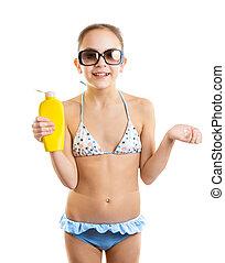 smiling girl in sunglasses holding bottle of suntan lotion