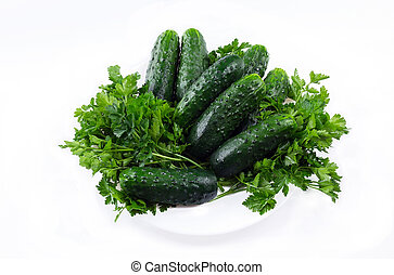 cucumber onions and parsley on a white background