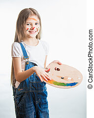 Isolated portrait of artist girl with face in paint -...