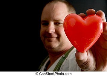 Cardiologist - A Cardiologist holding a heart shaped object