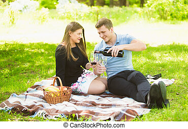 couple in love drinking red wine on picnic at park - Cute...
