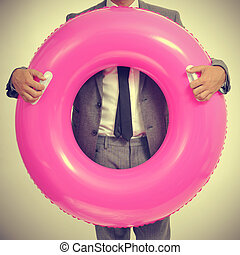 businessman with a pink swim ring, with a retro effect - a...