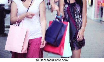 Women having fun shopping - Beautiful women laughing walking...