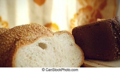 Slowmotion of Variety of bread and flour on the table in...