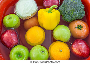 Composition with vegetables and fruits in basin