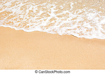 Closeup of sea wave rolling on the sand - Closeup shot of...