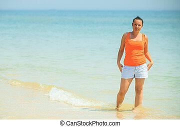 The woman on the sea coast Azov Sea