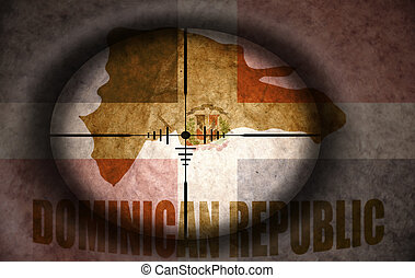 sniper scope aimed at the vintage dominican republic flag...