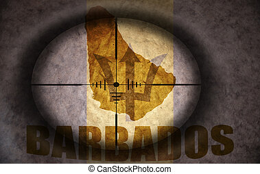 sniper scope aimed at the vintage barbados flag and map