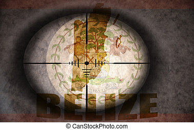 sniper scope aimed at the vintage belize flag and map