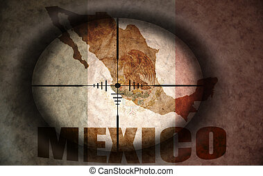 sniper scope aimed at the vintage mexican flag and map