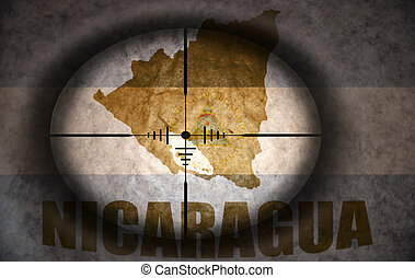 sniper scope aimed at the vintage nicaraguan flag and map