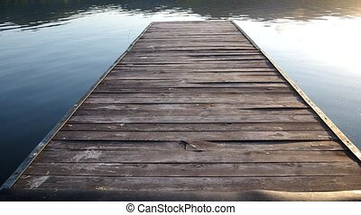 Walking on the pier lake - Walking on the boardwalk by the...