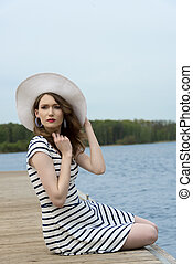 fashion girl in vacation on lake