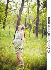 pregnant young girl - A young pregnant woman waiting for a...