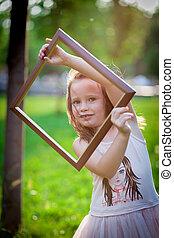 Girl and photoframe