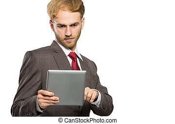 Young businessman with a tablet pc, serious expression, isolated