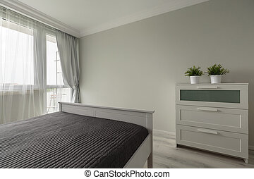 Simply modern bedroom furniture in white interior
