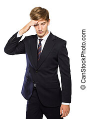 Young businessman confused, feeling stressed, hand in head...