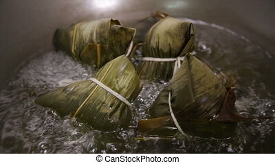 Zongzi boiling in a wok. Zhongzi is a traditional Chinese...