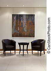 Luxury armchairs - Two modern armchairs with a table